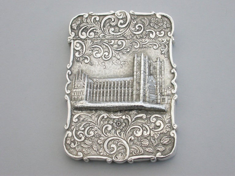 A good early Victorian silver castle-top Card Case chased and engraved with foliate scroll decoration, the face chased with a view of Westminster Abbey in high relief. The reverse with a shaped cartouche engraved with initials.
