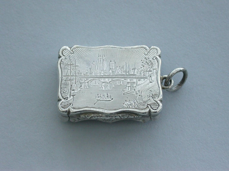 An extremely rare Victorian silver Castle-Top Vinaigrette of shaped rectangular form, the base with engraved tartan decoration surrounding a vacant cartouche, the lid engraved with a scene depicting Selby Bridge in Yorkshire with boats in the