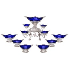 Victorian Silver Epergne and Suite of Six Dessert Baskets