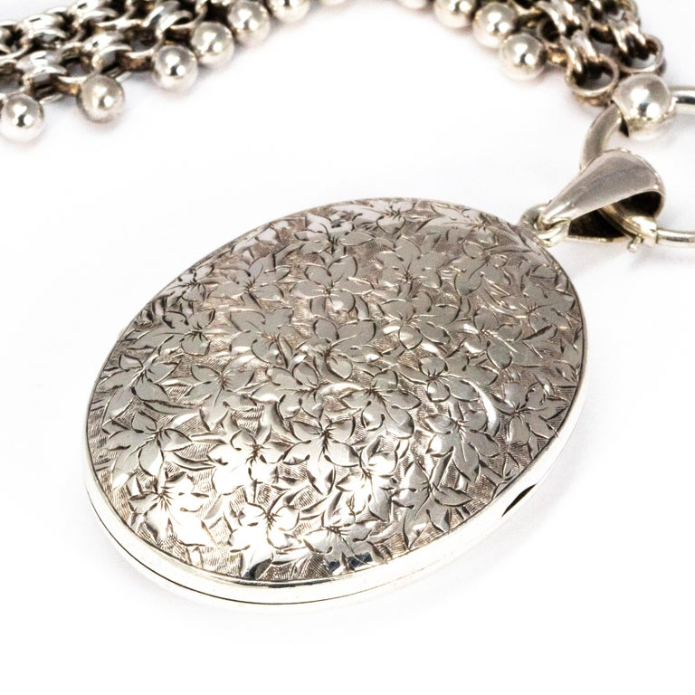 On this highly decorative and chunky chain is a locket. The locket has finely engraved leaves all over the front of it. The chain has beaded detailed chain with a chunky clasp.  Length: 42cm Chain Width: 13mm  Locket Dimensions: 35mm x 45mm