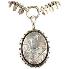 Victorian Silver Locket with Bird and Floral Detail