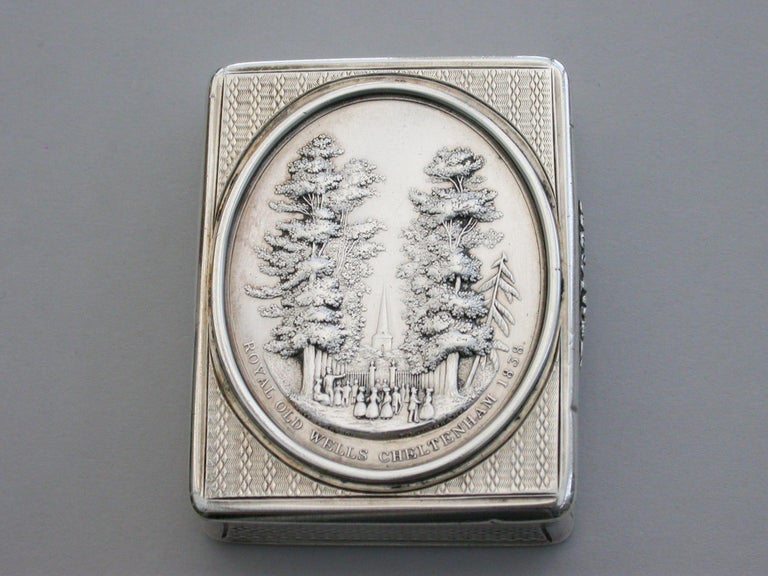 A rare early Victorian silver Snuff Box of compressed rounded rectangular form with engine turned decoration to the base and sides, the lid inset with signed silver medallion depicting The Royal Old Wells in Cheltenham and made to commemorate its