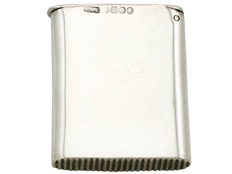 A fine and impressive antique Victorian English sterling silver and erotica enamel vesta case; an addition to our range of collectable silver cases  This fine antique Victorian sterling silver vesta case has a plain rectangular form.  The body