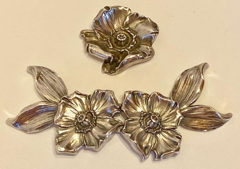 This wonderfully detailed Victorian sterling silver floral 2-Piece belt buckle with a matching floral sterling silver brooch. The 2-piece floral belt buckle measures 5 inches in length (when put together), 2 inches in width (or height), and 1/2