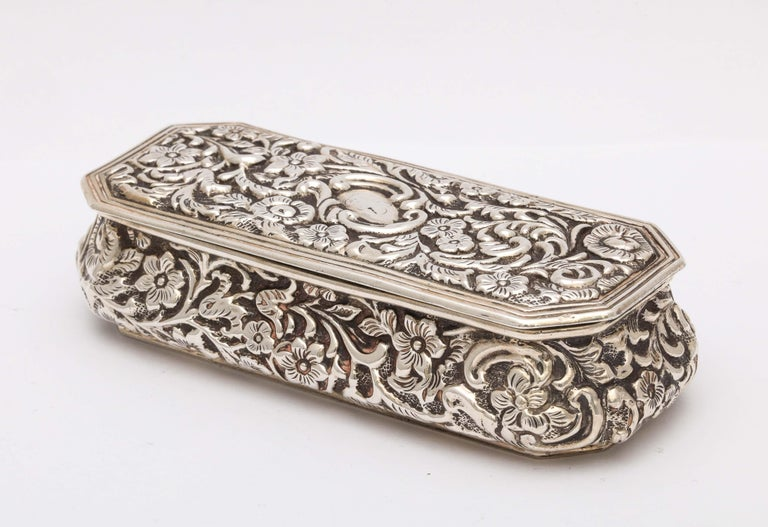 Victorian, sterling silver jewelry/trinkets box with hinged lid, Birmingham, England, year hallmarked for 1898, H. Matthews - maker. Lined with burgundy velvet. Underside of sterling silver hinged lid is gilded. Measures 4 3/4 inches wide x 2 inches