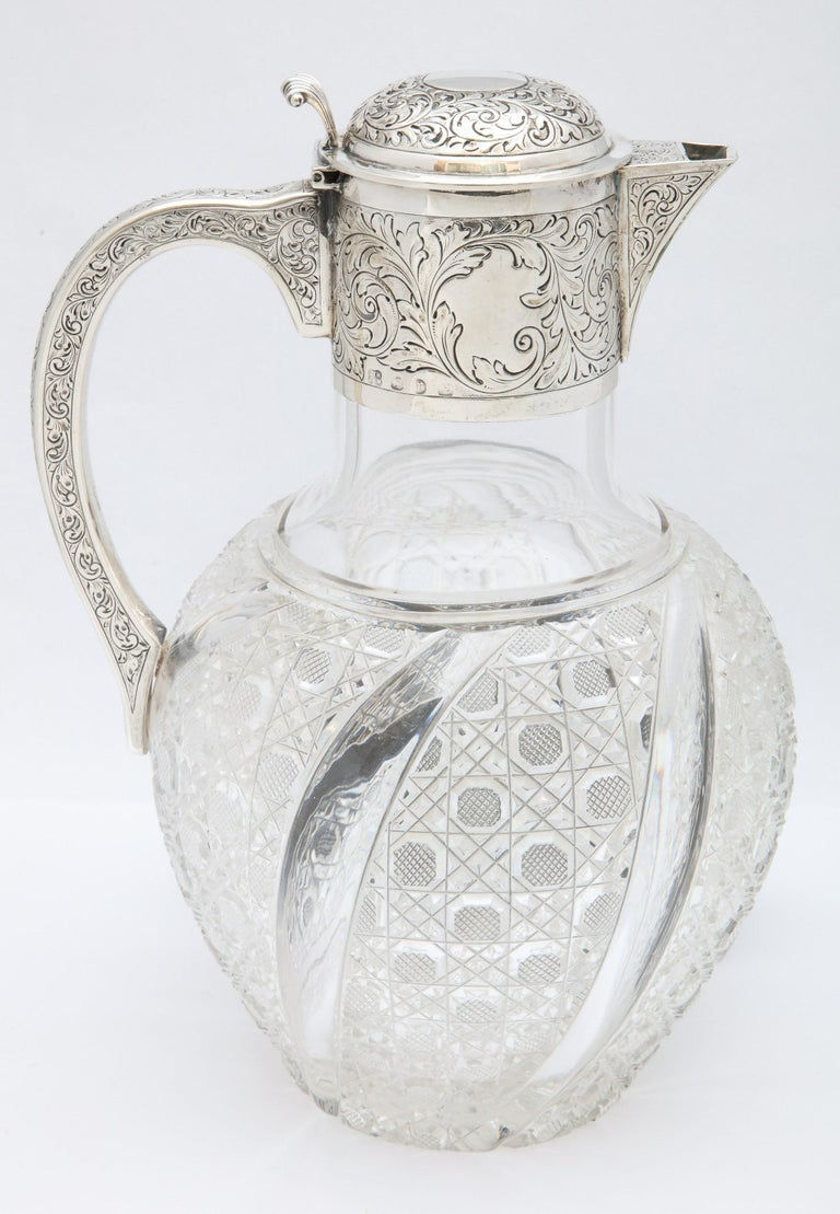 Large, Victorian, sterling silver-mounted hobnail-cut claret jug with hinged lid, Birmingham, England, 1891, John Thomas Heath and John Hartstone Middleton (who worked as Heath and Middleton), makers. Measures 10 1/2 inches high x 6 1/2 inches wide
