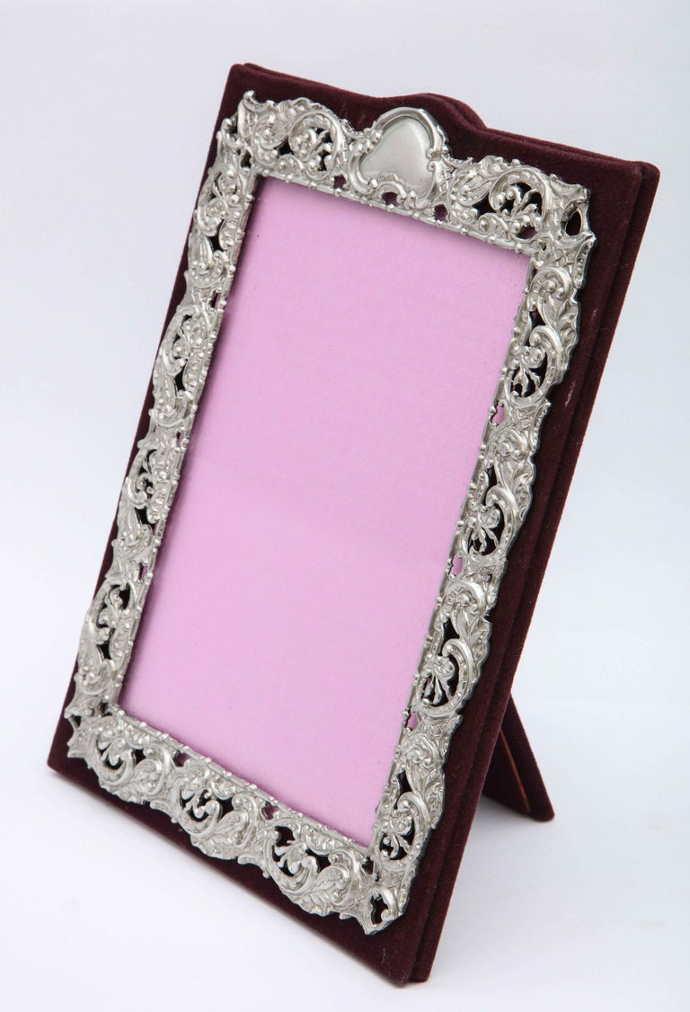 Victorian, sterling silver -mounted (on burgundy velvet) picture frame, Birmingham, England, year-hallmarked for 1898, Deakin and Francis - makers. Sterling silver has a matte finish, and is pierced so that the burgundy velvet shows through. Frame