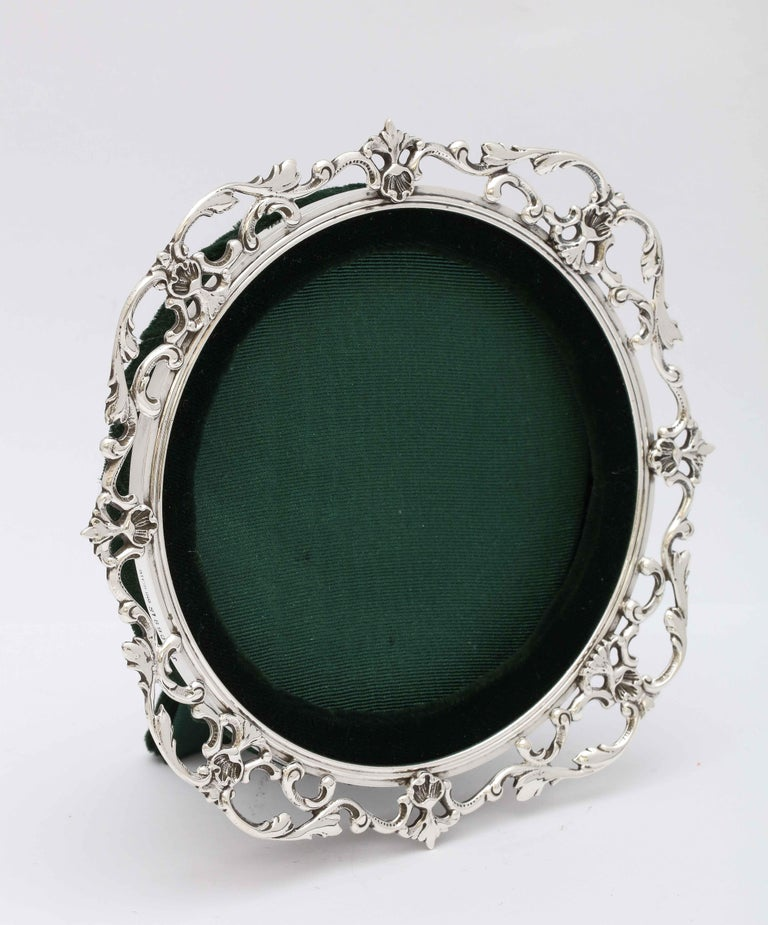 Victorian, sterling silver picture frame, Gorham Mfg. Co., Providence, Rhode Island, year-hallmarked for 1894. Measures 6 inches high x 6 inches wide; when easel is in open position, frame measures 3 1/2 inches deep. Frame will hold a photo 4 inches