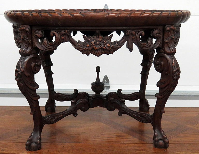 Victorian style inlaid glass top coffee table with beveled glass and ball and claw feet.