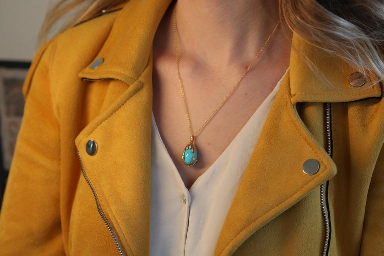 Winning its way into our hearts is this remarkably charming turquoise and diamond 18K yellow gold egg pendant.  A refreshingly coloured blue egg of turquoise sits in a rich cage of 18K yellow gold. The top loop of the pendant is embellished with