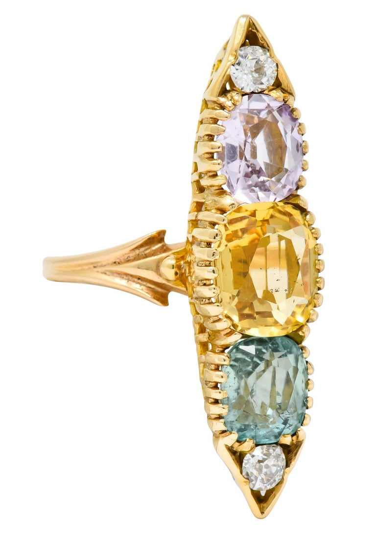 Dinner style ring with five well-matched pastel gemstones set vertically North to South in a pointed navette mounting  With two topaz weighing approximately 5.20 carats total, transparent orangey-yellow and light lavender in color  And one