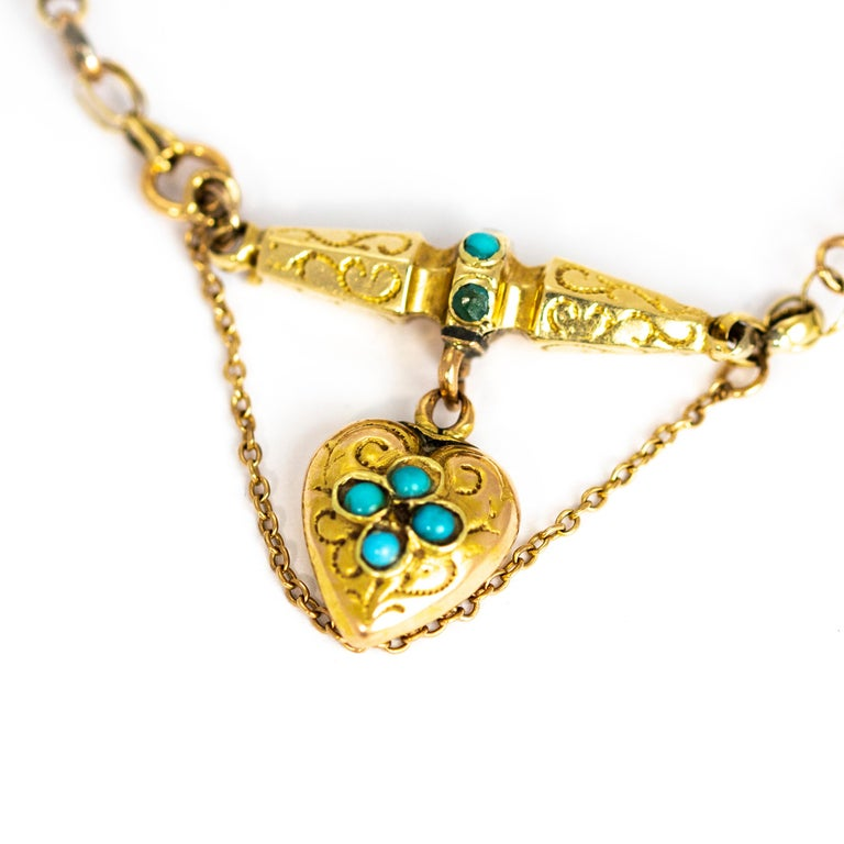 This charming heart pendant bracelet is full of detail. The large decorative links are delicately engraved and the main attraction is the heart pendant that hangs from one of these links. The heart id decorated with turquoise stones and more