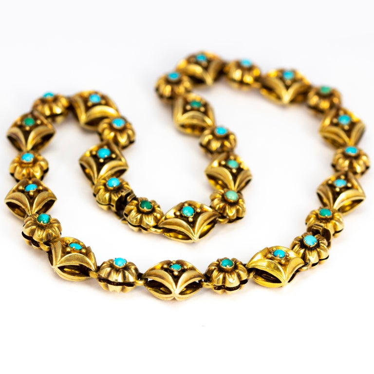 This victorian beauty could be a necklace or two bracelets. The two bracelets fasten to make a gorgeous necklace which is also double sided. On one side the gold has turquoise set into the centre of each link and on the other side is detailed flower