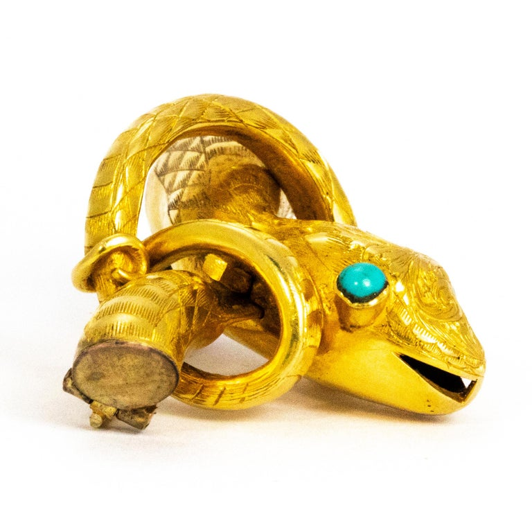 This wonderful snake brooch is so quirky and stylish! The eyes of the snake are set with turquoise and the body is modelled in yellow metal. The body is exquisitely engraved with the finest detail. As you will notice the detail on the face of the