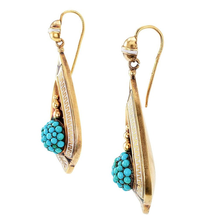 Victorian turquoise and enamel gold drop earring circa 1870.  The 18-karat yellow gold teardrop-shaped designs showcase circular turquoise clusters topped by trios of small graduating spheres, within a concave teardrop-shaped motif to a conforming,