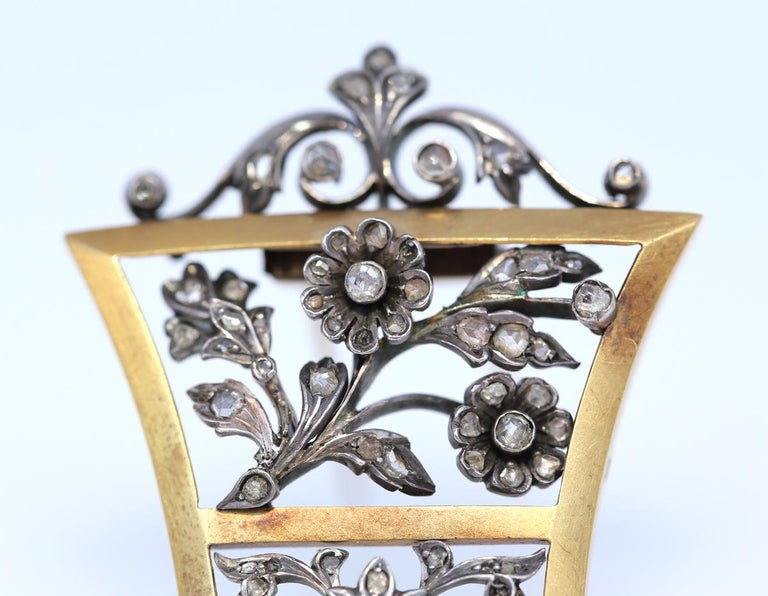 Unisex Victorian Brooch with Old-cut Diamonds. Gold & Silver. 1905. Delicate and fine work of the jeweler depicting flowers and natural ornament. The composition amazingly suggests that the natural motive shown in Silver, has grown into a Gold