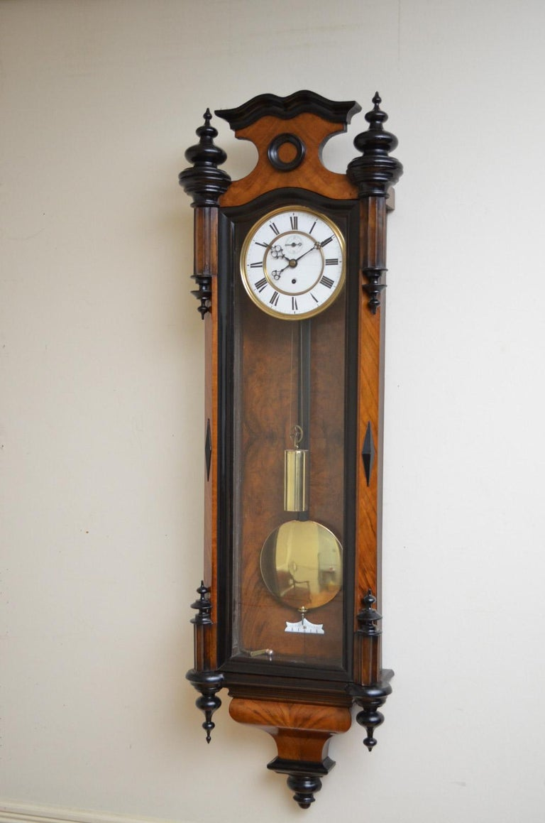 Sn2498 Victorian, figured walnut Vienna clock, having ebonized finials and canted corners with diamond decoration. The movement has been cleaned and serviced by a horologist and it is guaranteed for 12 months (UK Mainland), circa 1870