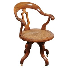 Victorian Walnut Desk Chair with Swivel Caned Seat, England, Late 19th Century