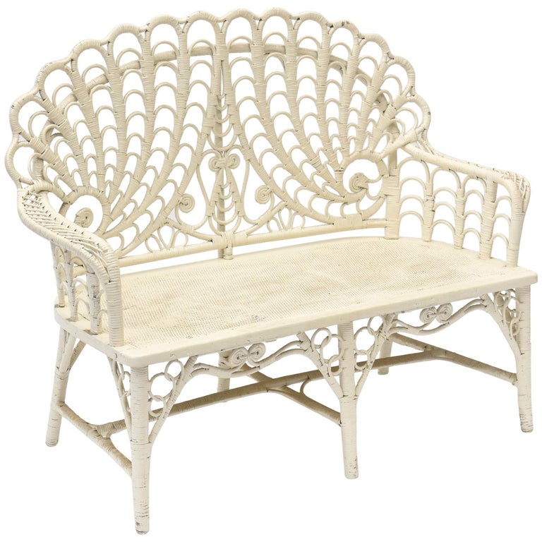 Victorian wicker love seat with shell back, 1880s, offered by Owl's Roost Antiques
