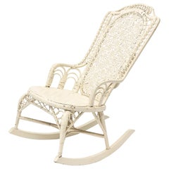 Victorian Wicker Rocker with Interlocking Circle Arms and Spider Woven Back