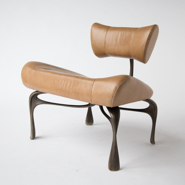 """New light leather victory lounge chair: leather and cast, burnished and patinated recycled magnesium-aluminum alloy made in Chicago, 2012/2016. A 2019 variation on the lounge chairs created for Victory at the Meadowlands in 2012-13. It is about 31"""""""