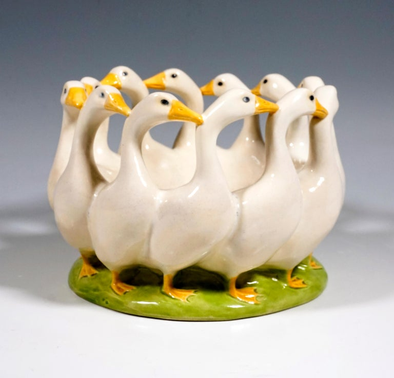 Art Nouveau ceramic centerpiece, twelve geese designed in a circle to form a bowl. White earthenware painted in color and glazed.  Designed by Michael MÖRTL (1878 - 1939) around 1905  Manufactured by 'Wiener Kunstkeramische Werkstätte' /= Vienna