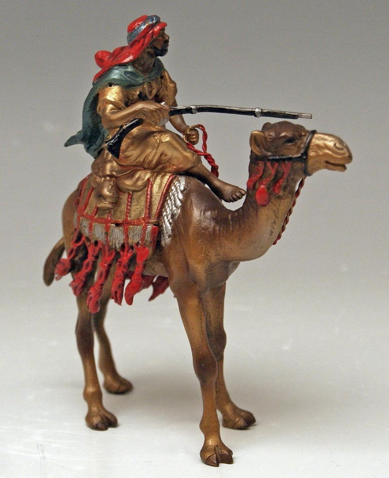 Stunning bronze figurine: Arab Man Riding on Camel  This finest bronze figurine manufactured by Franz Bergman is manufactured with greatest care;Arab Man Rides On A Camel / this bronze item is of stunning liveliness / the details are amazingly