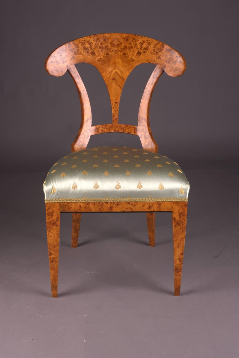 Solid beechwood with maple root veneer. Seat classical. Upholstered.