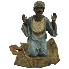 Vienna Bronze of Man Praying on Carpet