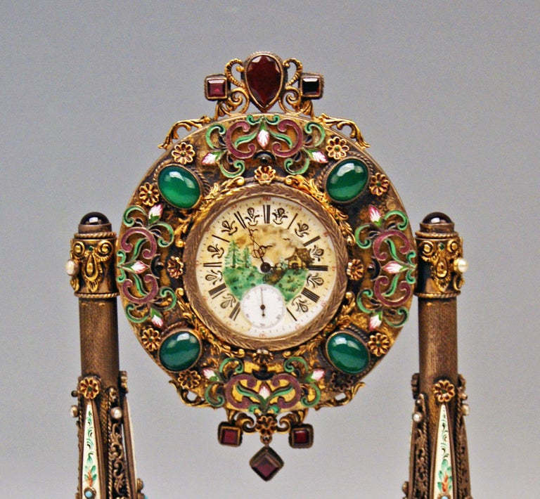 Stunning Viennese enamel vintage table clock - made of: -- silver  -- nacre -- enamel (excellently chiselled) -- onyx  -- semiprecious stones  Attention: The table clock is partially gilt !  Manufactured circa 1870  Table clock based on