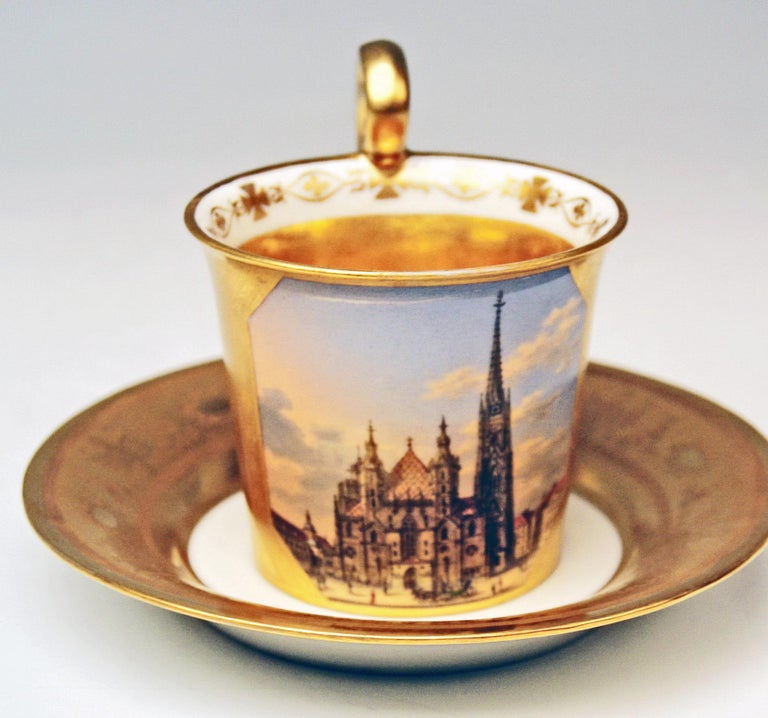 Antique Vienna cup with saucer abundantly painted: