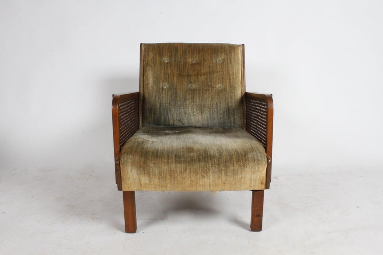 Vienna Secession style club or lounge chair with caned side panels and upholstery. Original finish on wood, older velvet reupholstery shows its age. Purchased this chair 20 plus years ago, was told the family brought it with them from Europe. In the