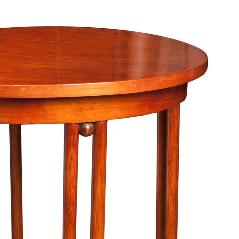 This table is made entirely of bent orange beechwood, varnished and polished. It is a fusion of two styles: Josef Hoffmann's Secession and Thonet's furniture aesthetics. The table has the original signature sticker under the top. Icon of European