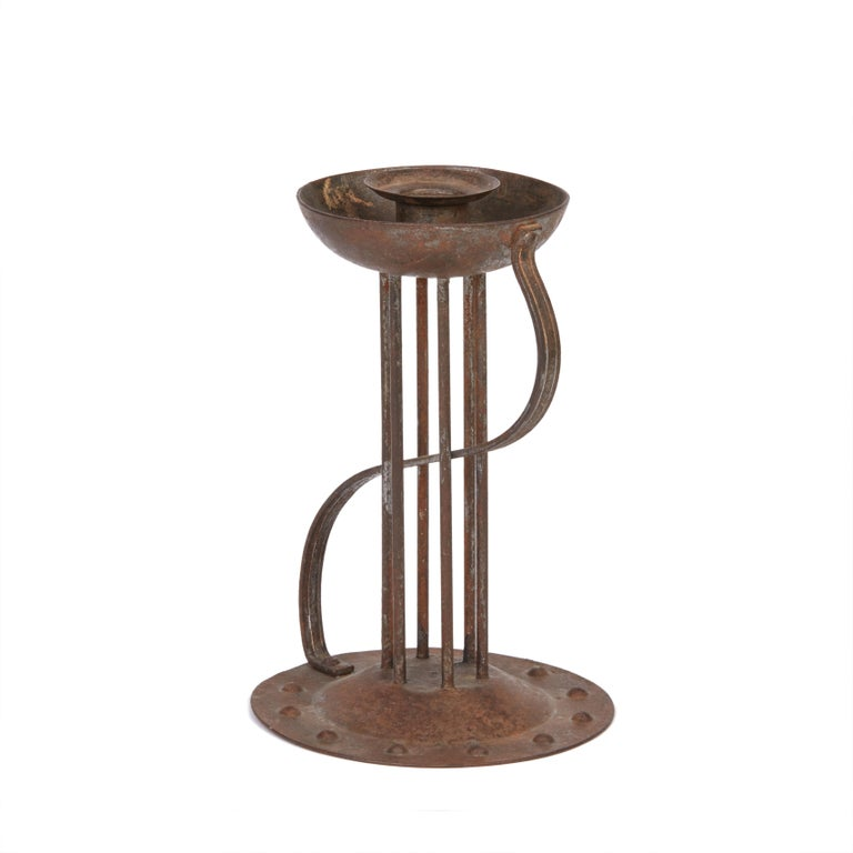 A stylish secessionist Industrial art iron candlestick or Chamberstick made and designed by Hugo bergère. As part of the Viennese secessionist movement the work of Hugo bergère was seen as cutting edge and was sold through a number of iconic outlets