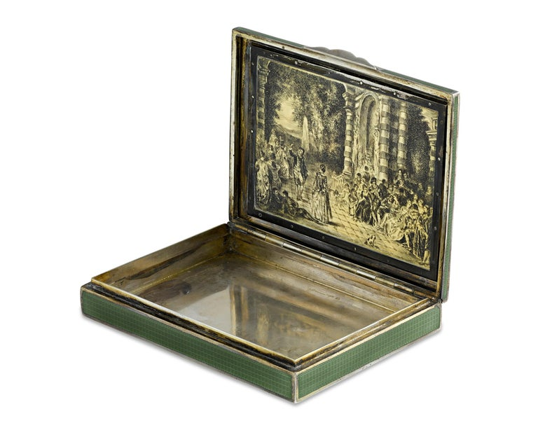 Crafted of fine 935 fineness of silver, this Viennese snuffbox is a testament to the country's time-honored and renowned tradition of enameling. The lid is graced by an intricate pastoral scene surrounded by a border of delicately hand painted