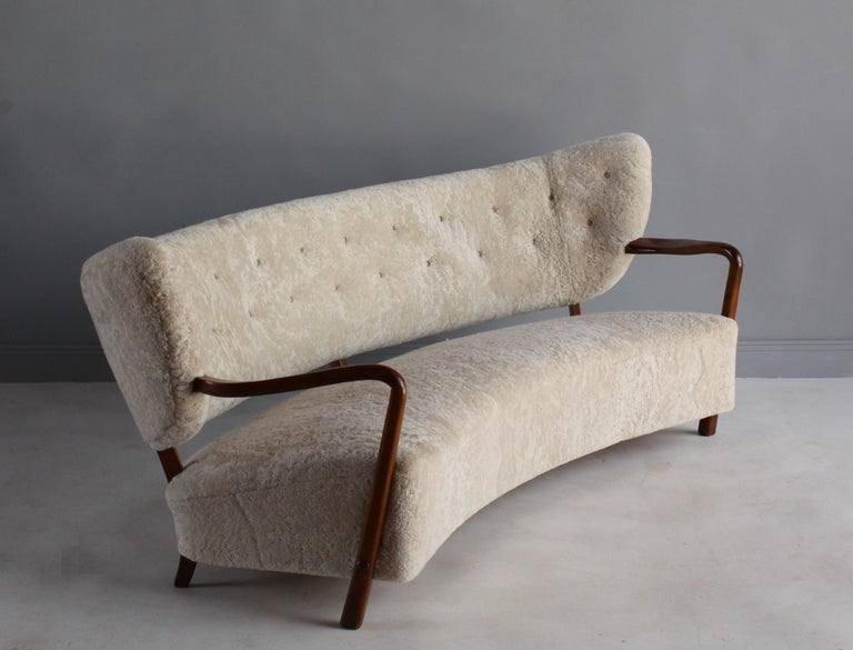 A highly modernist 1940s sofa attributed to Danish architect and designer Viggo Boesen. The soft organic / biomorphic form the sofa is enhanced by the authentic sheepskin / lambskin upholstery.   Other nordic designers include Kaare Klint, Philip