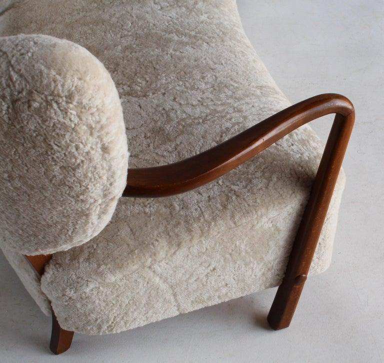 Viggo Boesen 'Attribution', Curved Modernist Sofa, Beech, Sheepskin, 1940s In Excellent Condition For Sale In West Palm Beach, FL