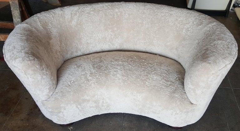 Scandinavian Modern Viggo Boesen Curved Sofa upholstered in Cream Shearling For Sale