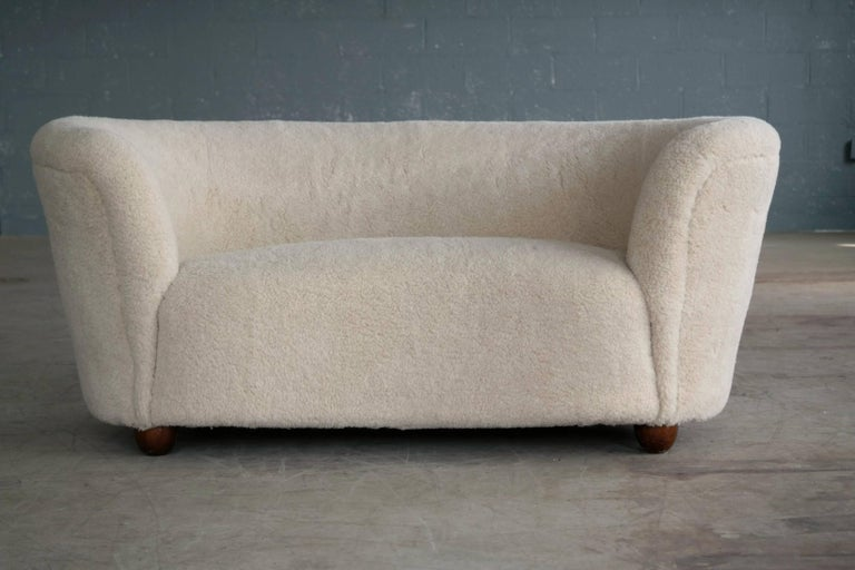 Mid-Century Modern Viggo Boesen Style Banana Shaped Curved Loveseat or Sofa Covered in Lambs, 1940s