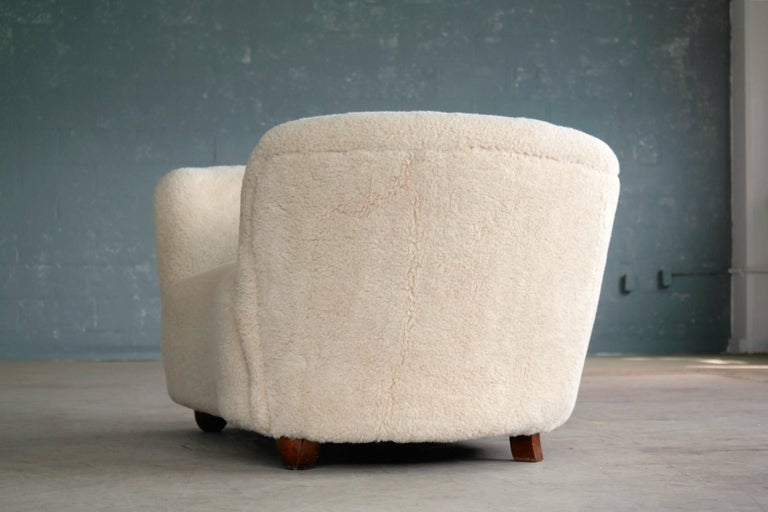 Wool Viggo Boesen Style Banana Shaped Curved Loveseat or Sofa Covered in Lambs, 1940s