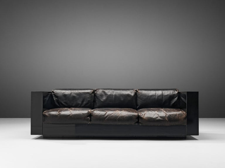 Massimo and Lella Vignelli for Poltronova, 'Saratoga' three-seat sofa, polyester lacquer and black leather, Italy, 1964  This three-seat sofa named 'Saratoga' is designed by Italian designer couple Lella & Massimo Vignelli. The Vignelli's were