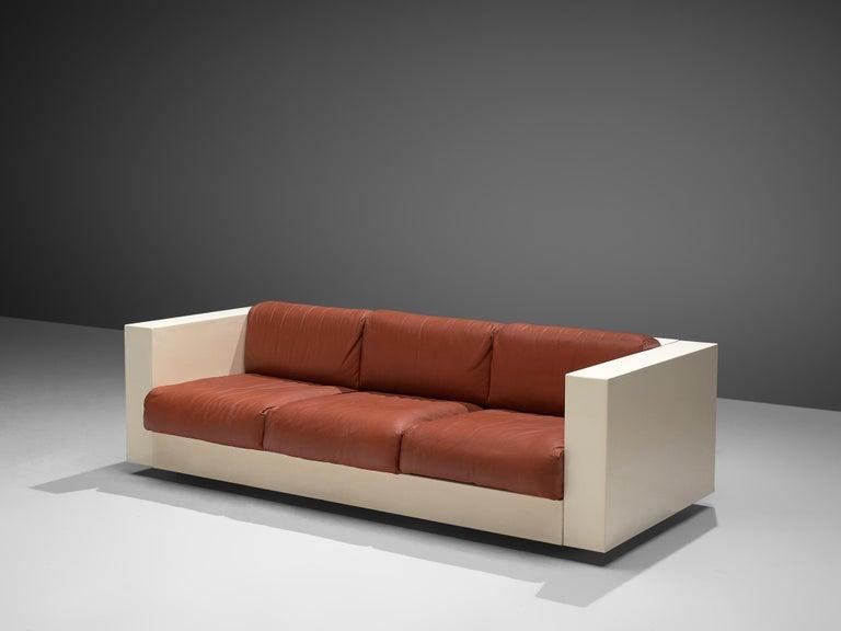 Massimo and Lella Vignelli for Poltronova, 'Saratoga' three-seat sofa, polyester lacquer and red leather, Italy, 1964.   The three-seat sofa named 'Saratoga' is designed by Italian designer couple Lella & Massimo Vignelli. The Vignelli's were known
