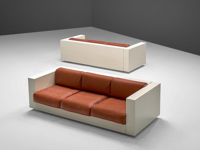 Massimo and Lella Vignelli for Poltronova, 'Saratoga' three-seat sofa, polyester lacquer and red leather, Italy, 1964.   The three-seat sofa named 'Saratoga' is designed by Italian designer couple Lella & Massimo Vignelli. The Vignelli's were