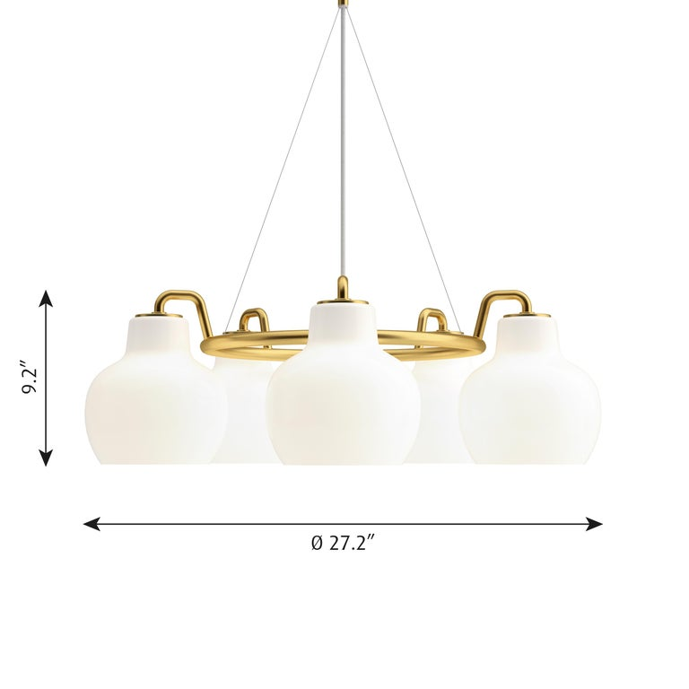Vilhelm Lauritzen 5-shade brass and glass ring chandelier for Louis Poulsen. Executed in five hand blown glossy white opal glass and untreated polished brass tube and ceiling canopy. The chandelier emits light directed primarily downwards. The opal
