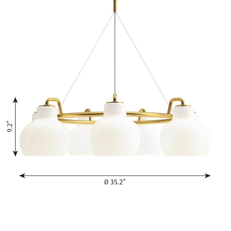 Vilhelm Lauritzen 7- shade brass & glass ring chandelier for Louis Poulsen. Executed in seven hand blown glossy white opal glass and untreated polished brass tube and ceiling canopy. The chandelier emits light directed primarily downwards. The opal