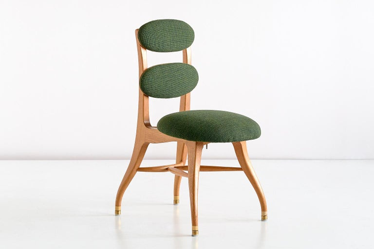 This rare chair was designed by Vilhelm Lauritzen for the iconic Radiohuset building in Copenhagen in the 1950s. The chair was specifically designed for the orchestra musicians to be seated comfortably in the building's concert hall. An archival