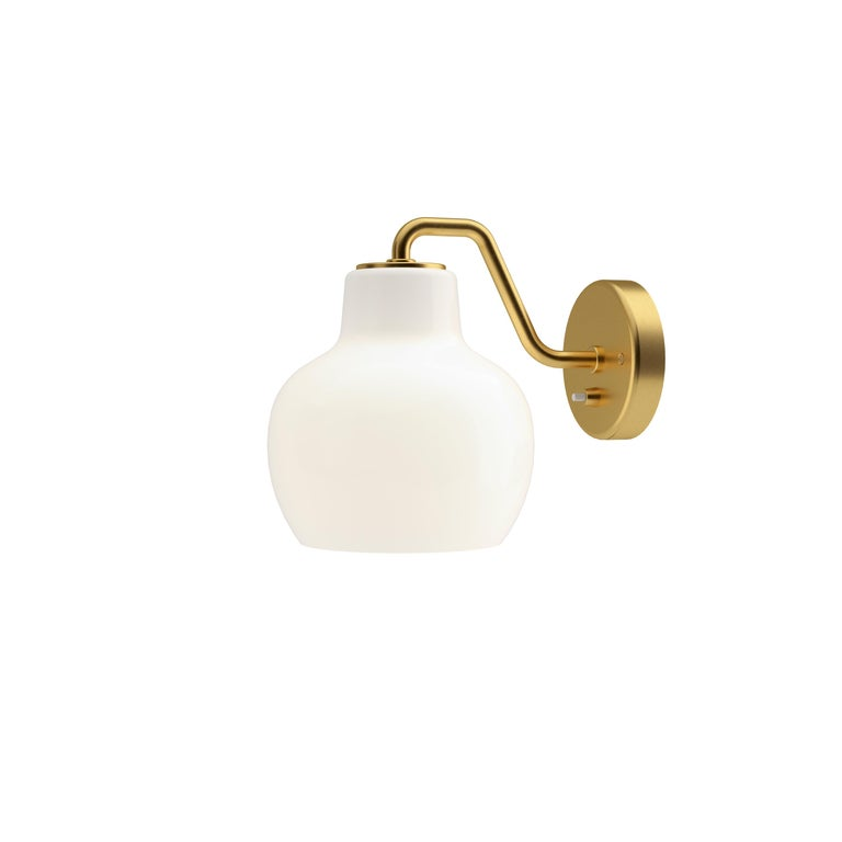Vilhelm Lauritzen VL-1 brass and glass wall lamp for Louis Poulsen. Executed in a single hand blown glossy white opal glass and unfinished satin polished brass armature and backplate. The sconce emits light directed primarily downwards. The opal
