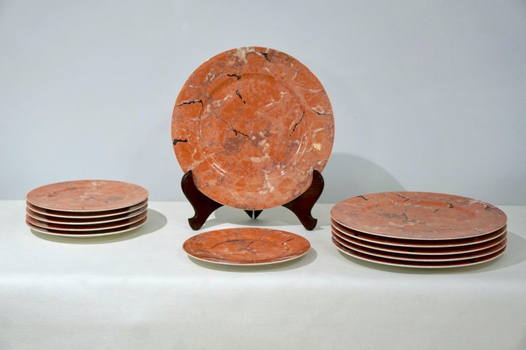 A set of 12 pieces, 6 large plates / placemats and 6 smaller dessert/cheese plates, a  discontinued production in vitro porcelain by the European Villeroy & Boch company, decorated in a variegated pattern to resemble marble, in orange pink Siena