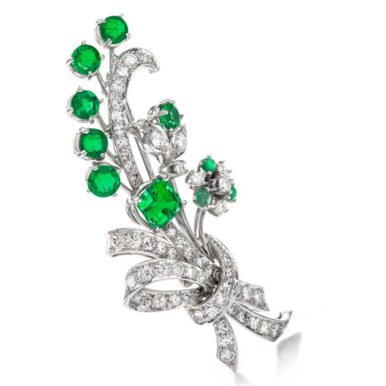 Feature this bouquet on the table.   This lavish antique floral inspired Art Deco brooch pin features 7 rich and exotic Columbian Emeralds with Extreme transparency and vibrant green color.  Crafted in Luxurious Platinum, This brooch pin contains