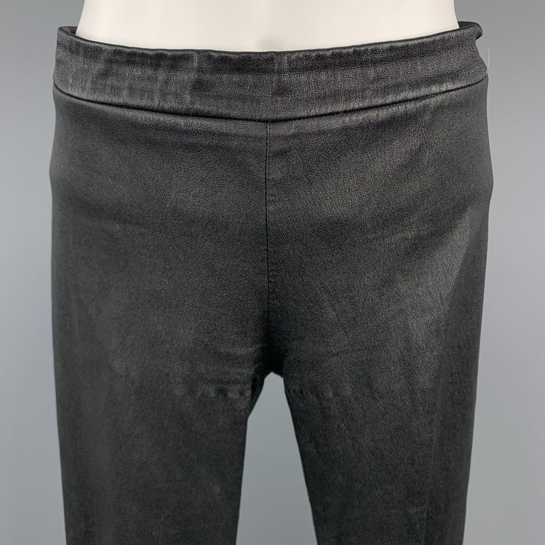 VINCE Leggings comes in a black solid textured leather material, with a flat front, center split on back hem and cuff zipper, form fitting, in a pull on style. Minor wear.   Very Good Pre-Owned Condition. Marked: S  Measurements:  Waist: 28 in.